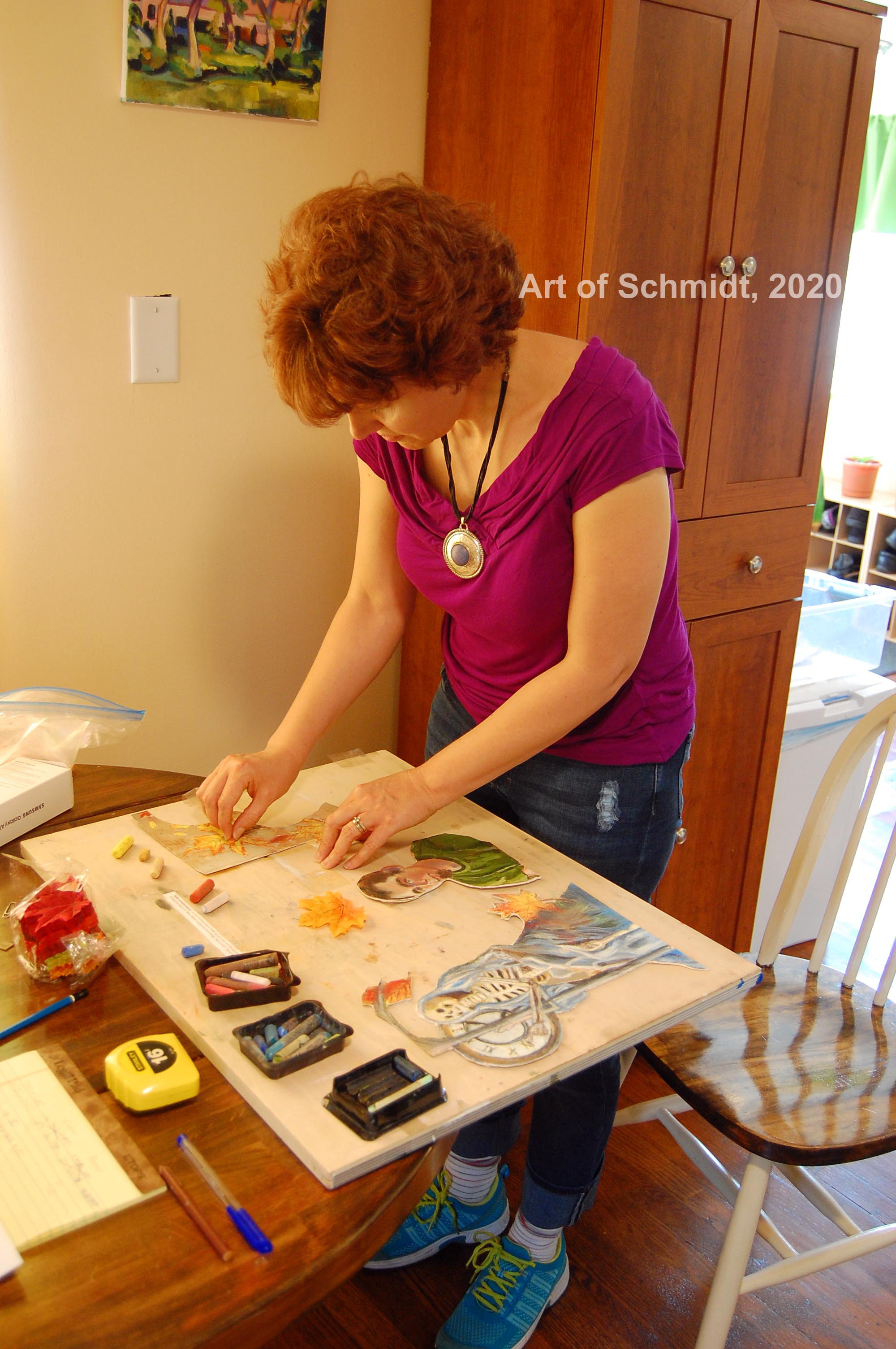 Artist at work, with watermark